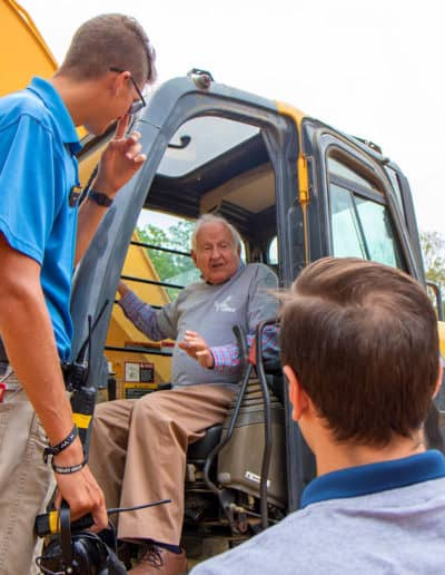 Man gets instruction on excavator for his XL birthday